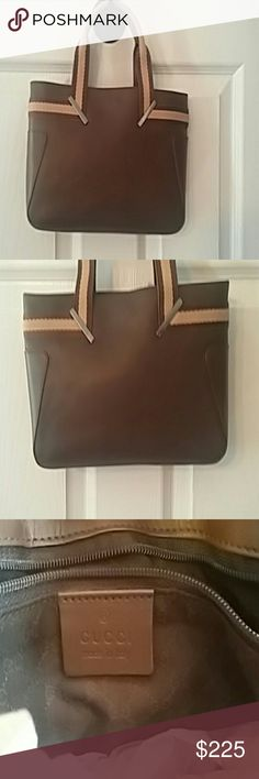 "Gucci Handbag.  Brown Leather with Canvas Handle Gucci Handbag.  Brown Leather  (not sure if it is real leather ). Has canvas handles. One main compartment with one back zipper compartment.  Used a few times. Has dust bag. It is in pretty good condition.  It has a few minor scratches that you can't notice unless you are up close to it. Measures 10"" ? 7"". Measures 4""  from the top of the handle to the top of the bag.  Smoke-free home Gucci Bags"