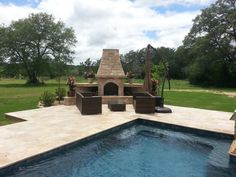 Outdoor fireplace with seating, you can enjoy your pool day or night.