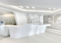 Designed by Zurich based international design firm NAU Architecture in collaboration with studio Drexler Guinand Jauslin, the interior of the Open Lounge connect the hist Zurich, Shop Interiors, Office Interiors, Modern Interiors, Beautiful Interiors, White Reception Desk, Office Reception, Reception Areas, Futuristic Interior