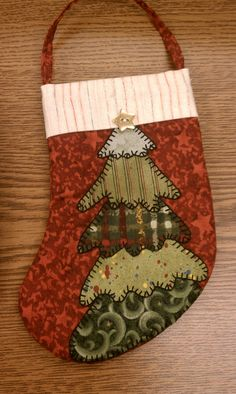 Christmas Stocking. Would be cute with felt- different shades of green and button ornaments.