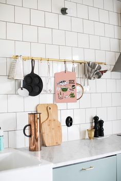 Subway tiles and copper kitchen ware