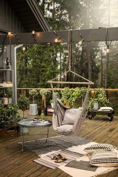 Outdoor balcony hammock and lots of pillows
