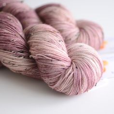 Hand Dyed Tweed Sock Yarn - Superwash Merino / Nylon 438 Yards - Persephone in Pomegranate Purple and Warm Pink. $28.00, via Etsy.