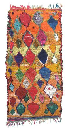 Spectacular Vintage Boucherite rug in vibrant abstract diamond pattern with braided tassels at one end. This unique piece of the Berber art culture