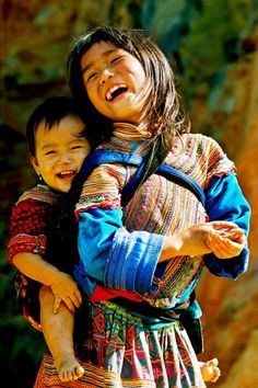 What a couple of beautiful smiles... Title unknown; Native American children -- by Alredo Rodriguez