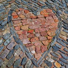 brick and stone inlaid heart--I TOTALLY want this--anywhere in my yard or house or bedroom or bathroom or kitchen or living room or--well you get the idea. Heart In Nature, Heart Art, Brick And Stone, Stone Art, Garden Paths, Garden Art, Garden Stones, I Love Heart, Jolie Photo