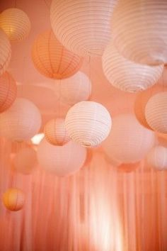 Paper lanterns are a fun way to decorate a large space with a high ceiling! A boring ceiling isn't any fun, so liven it up with some simple and cheap decor!