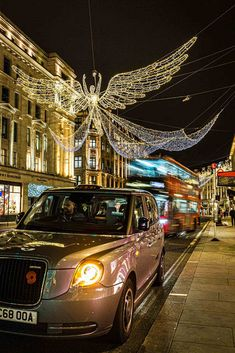 Christmas Angels on Regent street, London, England and a London taxi and bus