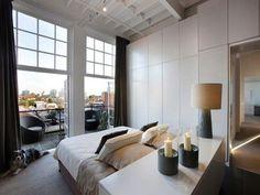 Penthouse-Melbourne-Turned-Bed-Facing-Patio-Remodelista Home Bedroom, Bedroom Furniture, Master Bedroom, Bedroom Decor, City Bedroom, Bedroom Ideas, Bedroom Balcony, Headboard Ideas, Bedroom Windows