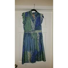 Gorgeous #silk dress ! Beautiful 100% silk dress in shades of blue and green. At the knee or slightly above. Side zipper. Cute tie at the neckline. Dresses