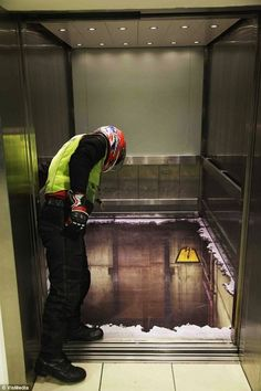 Elevator optical illusion (the floor is perfectly fine, but has an interesting pieces of art on it :))