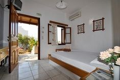 Villa Mata Ios Greece - Cycladic style room, white and wood decor, elegant and modern accommodation by the sea Greece, Ios, Villa, Elegant, Modern, Furniture, Home Decor, Style, Greece Country