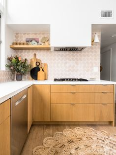 Interior designer Natalie Myers broke her own golden rule and made one major renovating mistake when she first moved into her home. Wood Cabinets, Kitchen Cabinets, Island Kitchen, Cheap Tiles, Pink Tiles, Minimalist Scandinavian, Mid Century House, Tile Patterns, Kitchen Design