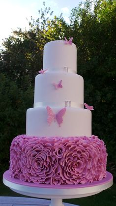 Pink ruffles and butterflies wedding cake