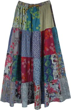 A mixed patchwork cotton skirt with various abstract prints, full maxi length with an elastic waist and drawstring. The elastic waist adds comfort and stretch and drawstring gives you sizing flexibility and a confident fitting. #tlb #Patchwork #MaxiSkirt #Floral #Printed #bohemianfashion #Handmade #PatchworkMaxiSkirt #BohemianSkirt #HippieSkirt
