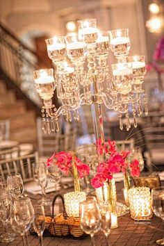 Arts Ballroom wedding reception, Jordan Brian Photography, Double tiered crystal candelabra surrounded by magenta Phalaenopsis orchid arrangements