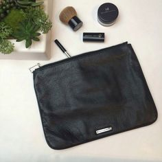 "NEW ListingRebecca Minkoff leather pouch Rebecca Minkoff black pebbled leather zip pouch. Great to use as a cosmetic case or a clutch for quick errands. One interior slip pocket. 9.5""W X 7.5""H X 0.5""D. Not interested in trades. Rebecca Minkoff Bags Cosmetic Bags & Cases"