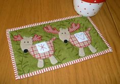 Reindeer Mug Rug pattern $1.99 on Craftsy at http://www.craftsy.com/pattern/quilting/home-decor/reindeer-mug-rug/53309