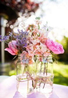 wedding flowers in jam jars