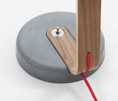 Lamp base detail. Laminated wood and concrete