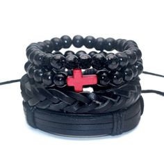 This multi-layer bracelet is a 4-piece set that includes 2 beaded bracelets made of 8mm bamboo wood in black with a stone cross in red and 2 black pull-closure leathers in black. Style up any outfit  and wear them together or split them up.  It's a versatile bracelet set for men and women and with an elastic rope material, they'll comfortably fit just about any wrist.  Material: Bamboo, Stone, Leather Chain: Elastic Rope Beads Size: 8mm Wrap Length: 19-21 cm