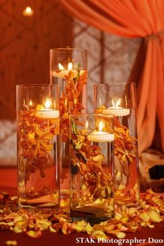 faLL wedding reception decorations   Orange and Gold Wedding Decor http://www.maharaniweddings.com/2013/01 ...