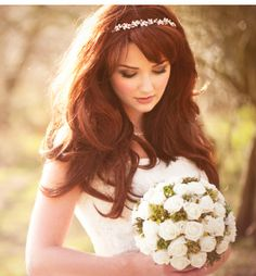 This style is ideal for those with naturally wavy hair. Those with straight hair should use a large barrel curling iron or soft hair rollers to achieve loose waves. Use a volumizing hairspray to give roots a lift and accessorize with a wedding headband.