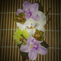 Tropical hairpiece with green white and lavender flowers with stick embellishment available for $14 plus shipping. ..leave your email to purchase.  #deadlydinaaccessories #tikioasis #tiki #luau #tropical #hawaiin #whiteflowers #lavender #green #hairflowers #hairpiece #hairaccessories #vintageinspired #pinup #retro #rockabilly