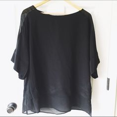 NWT Banana Republic Silk Black Blouse New with Tags ordered online. silk black blouse top from Banana Republic. Super cute on, runs oversized! size large. As always, comes from a smoke free home and no trades :) Banana Republic Tops Blouses