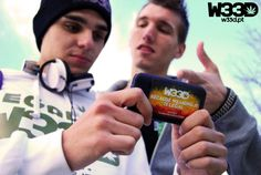 Two of our models with one of the official #W33D stickers we offer with every order.