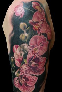 The Realistic One. With the bold back BG and the loud elements above, this orchid tattoo looks so realistic.