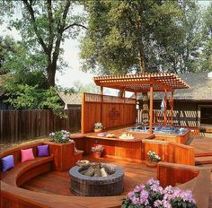 Redwood deck with built-in circular seating area with fire pit and designated area for hot tub.