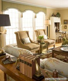 A pretty shape for a triple window...Shaped cornice with trim and tassels~ to consider if I ever decide on window treatments.