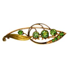Lily of the Valley Russian Demantoid Brooch c1910 | From a unique collection of vintage brooches at http://www.1stdibs.com/jewelry/brooches/brooches/