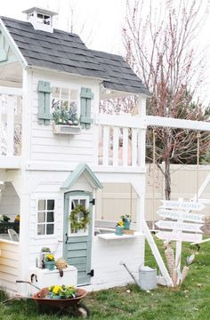 Playhouse in the spring. Playhouse makeover. Maymeandmom.com #playhousesforoutside #buildachildrensplayhouse #outdoorplayhouseideas