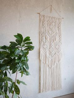 Macrame wall hanging, made of natural cotton cord. Beautiful decoration to your house, which will give it a unique atmosphere. Handmade with attention to every detail. length: about 47 in (120 cm) width: about: 17 in (43 cm) color: natural (ecru)