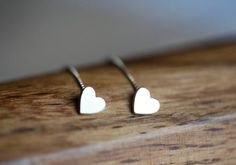 A pair of beautiful heart earrings. Simple and cute. Perfect gift for your wife or girlfriend!