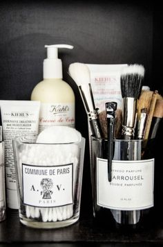 repurposed glass candles, organized medicine cabinet, make-up & toiletries