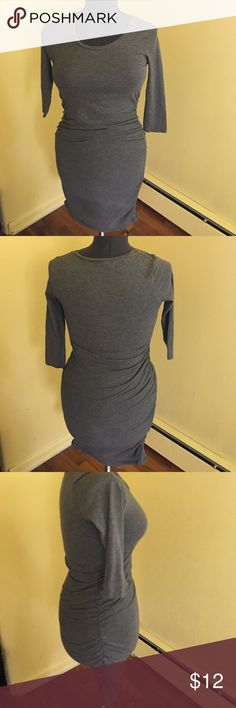 Gray 3/4 dress 3/4 length sleeves. Dress goes past knee caps. Super stretchy with scrunching down the sides Express Dresses