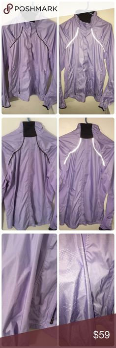Lululemon lavender purple women's light jacket Size 12 dot confirmed inside one of the pockets. Also has a hole inside pocket for headphones to go through the jacket. Has two zip-closure pockets. Pictures taken with and without flash to show how it looks when light is reflecting on it. Great breathable light-weight jacket with a perforated back. lululemon athletica Jackets & Coats