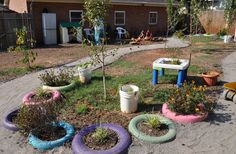 How to paint tire planters - this post has great tips and tricks for making these durable and kid-friendly planters!