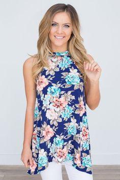 Shop our Sleeveless Floral Print Tunic in Navy. Pairs perfectly with our white distressed skinny jeans. Free shipping on all US orders!