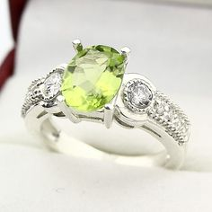 Natural Green Peridot ring. Love the shade of green and not to mention the BLING!
