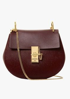 """I've been dragging my feet over the end of summer, but this Chloé cross-body bag is selling me on fall. The apple-crisp shape in deep burgundy—using a textural play of creamy leather and calf hair no less—has me day dreaming of oversize cashmere and well-cut wool."""