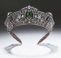 Harcourt Emeralds' - a magnificent emerald and diamond necklace composed of thirteen step-cut emeralds with three-stone diamond links - for £1,870,000. This remarkable necklace was worn at the 1937 coronation of King George VI by the Dowager Viscountess Harcourt.