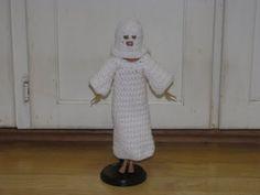 it's a crochet costume for Barbie. is she a ghost? KKK member? condom???