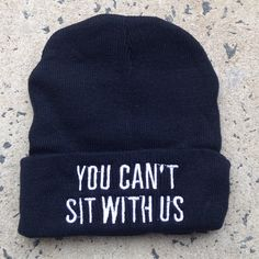 Black beanie with white embroidered wording