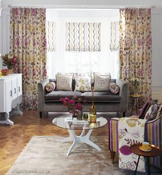 Floral patterned curtains with wavy patterned roman blinds
