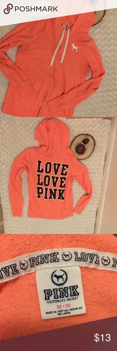 PINK VS Zippered Long Sleeve Hoodie This cozy hoodie is pre-owned and gently used with a lot of wear (please see photos). Size Medium. Color: Coral. PINK Victoria's Secret Jackets & Coats