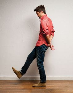 The classic easy look. Desert boots, dark blue jeans, and a rolled casual button shirt